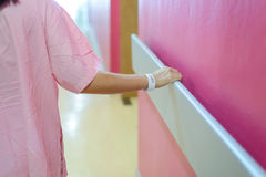 Women patient hand holding to handrail in hospital Stock Image