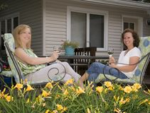 Women on Patio Framed by Flowers Stock Photo