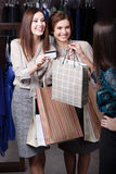 Women pay with credit card. Pretty women pay with credit card Royalty Free Stock Photos