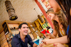 Women paying for drinks at the bar Stock Image