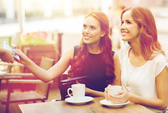 Women paying money to waiter for coffee at cafe Royalty Free Stock Photo