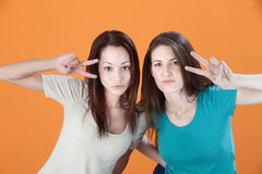 Women with Peace Symbol Hand Signs Stock Image