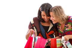 Women peeking at the bags Royalty Free Stock Photography