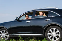Women peering out of car windows Royalty Free Stock Photos