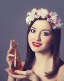 Women with perfume. Stock Photos