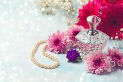 Women perfume bottle and pearl necklace Royalty Free Stock Image