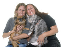Women and pet. In front of white background stock photography