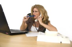 Women on the phone. A business woman phoned in office Royalty Free Stock Images