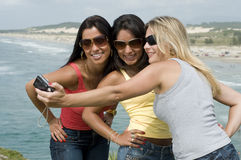 Women photograph on the beach Stock Photography