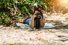 Women photographers take photos Butterfly