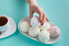 Women pick pastel colored marshmallow Royalty Free Stock Image