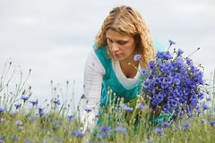 Women picking blue flowers Stock Images