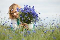 Women picking blue flowers Royalty Free Stock Photo