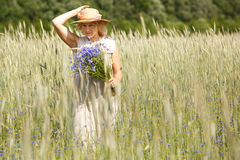 Women picking blue flowers Stock Photos