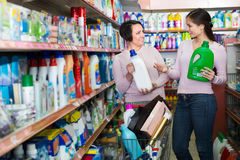 Women picking bottles with detergent Royalty Free Stock Photo