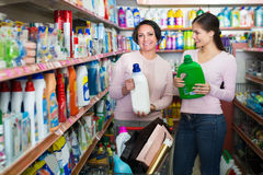 Women picking bottles with detergent Stock Photography