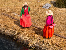 Women on pier in Reed Islands on Lake Titicaca, 6/13/13 Stock Photo