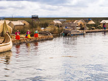 Women on pier in Reed Islands on Lake Titicaca, 6/13/13  on Lake Stock Image