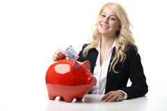 Women with piggy bank Stock Images