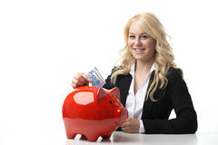 Women with piggy bank Royalty Free Stock Photos