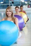 Women with pilates ball Royalty Free Stock Photography