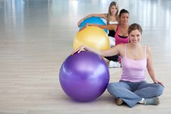 Women with pilates ball Royalty Free Stock Photo