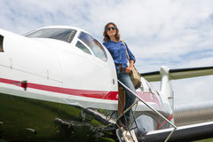 Women pilot. The young beautifu woman is a pilot the small plane Stock Image