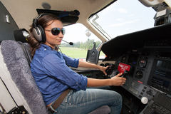 Women pilot. The young beautifu woman is a pilot the small plane Stock Photography