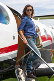 Women pilot. The young beautifu woman is a pilot the small plane Royalty Free Stock Photography