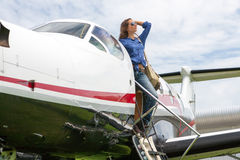 Women pilot. The young beautifu woman is a pilot the small plane Royalty Free Stock Image