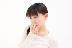 Women pinch the nose Royalty Free Stock Images