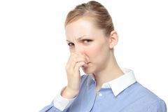 Women pinch the nose Royalty Free Stock Photo