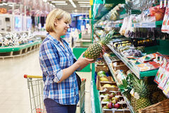 Women with  pineapple shopping Stock Photography
