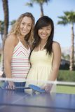 Women With Ping Pong Bats Stock Photography