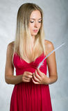 Women in pink dress with white feather Stock Photos