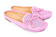 Women pink flats slip-on with small ribbon shoes isolated on whi. Te background Royalty Free Stock Photo