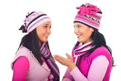 Women in pink knitted clothes having conversation stock photo