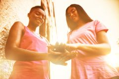 Women in pink outfits standing for breast cancer awareness royalty free stock photos