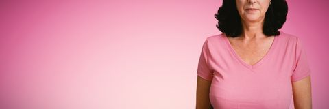 Composite image of women in pink standing royalty free stock photo