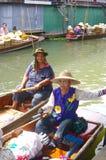 Women on pirogue stock photography
