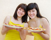 Women with pizza Stock Photography