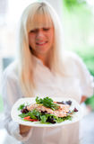 Women with plate of salmon and salads Stock Photos