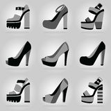 Women platform high heel shoes icons set on gray gradient background Royalty Free Stock Image