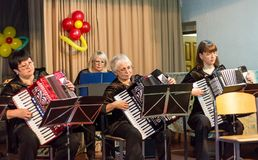 Women play on the accordion Stock Images