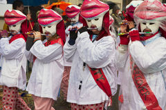 Women play flutes at Basel Carnival in Basel, Switzerland. Royalty Free Stock Images