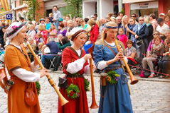Women play music during Landshut Wedding. Three women play music during the 2013 Landshut Wedding in Southern Germany,the historical pageant takes place every Royalty Free Stock Photos