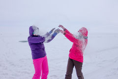 Women play in the snow during a snowfall on the ice of Lake Baik Royalty Free Stock Image
