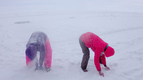 Women play in the snow during a snowfall on the ice of Lake Baik Stock Photography