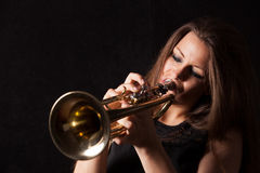 Women play trumpet Stock Photo