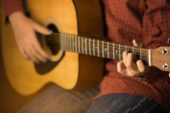 Women playing acoustic guitar Royalty Free Stock Photo